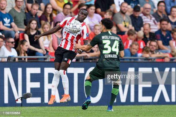 Bruma of PSV Eindhoven and Michael Edwards of VfL Wolfsburg battle for the ball during the pre-season friendly match between PSV Eindhoven and WfL...