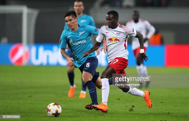 Bruma of RB Leipzig and Matias Kranevitter of FC Zenit Saint Petersburg compete during the UEFA Europa League Round of 16 match between RB Leipzig...