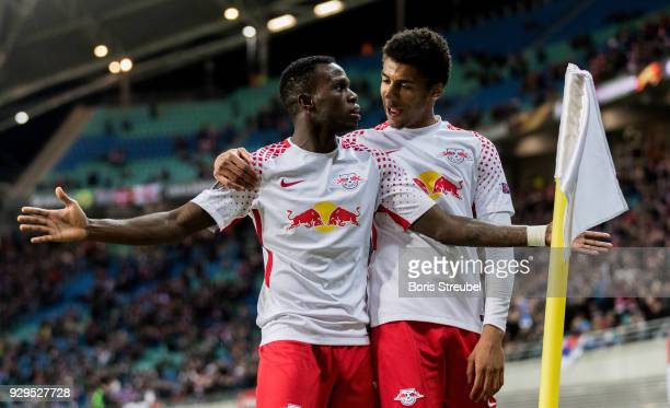 Bruma of RB Leipzig celebrates with team mate Bernardo after scoring his team's first goal during UEFA Europa League Round of 16 match between RB...