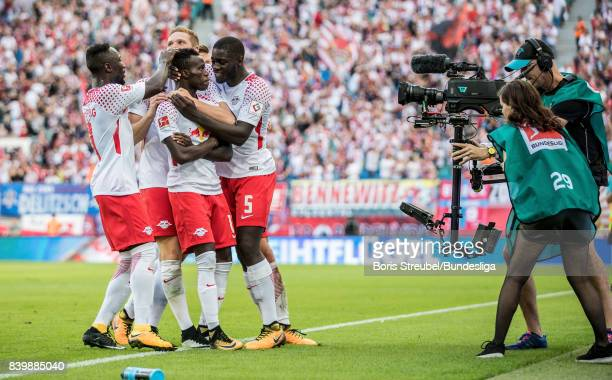 Bruma of RB Leipzig celebrates with team mates after scoring his team's fourth goal during the Bundesliga match between RB Leipzig and SportClub...
