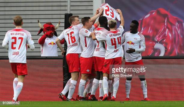 Bruma of RB Leipzig celebrates with team mates after scoring his team's first goal by showing the jersey of player Marcel Halstenberg of RB Leipzig...