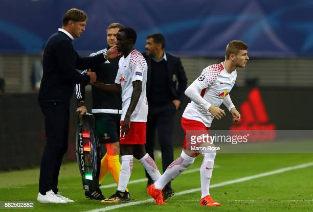 Bruma of RB Leipzig comes off the pitch and is replaces by Timo Werner of RB Leipzig during the UEFA Champions League group G match between RB...