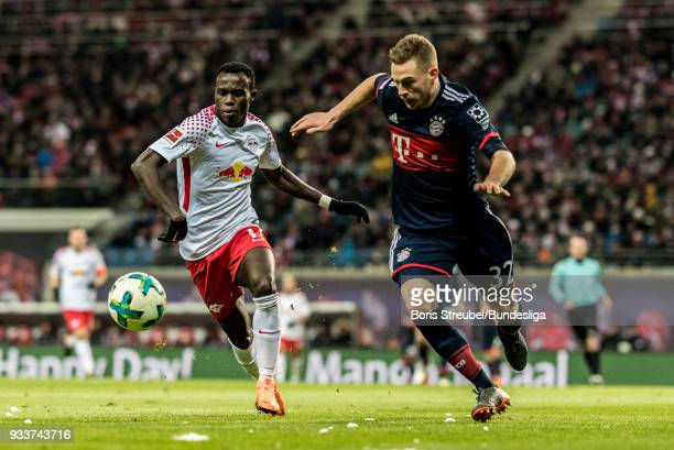 Bruma of RB Leipzig in action with Joshua Kimmich of FC Bayern Muenchen during the Bundesliga match between RB Leipzig and FC Bayern Muenchen at Red...