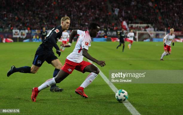 Bruma of RB Leipzig is challenged by Arne Maier of Hertha BSC during the Bundesliga match between RB Leipzig and Hertha BSC at Red Bull Arena on...