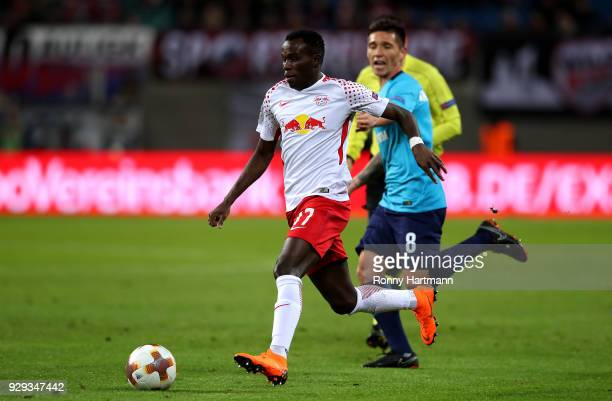 Bruma of RB Leipzig vies with Matas Kranevitter of FC Zenit Saint Petersburg during the UEFA Europa League Round of 16 match between RB Leipzig and...