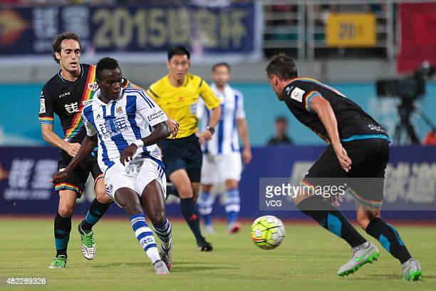Bruma of Real Sociedad and Raul Baena of Rayo Vallecano compete for the ball during a friendly match between Real Sociedad and Rayo Vallecano at...