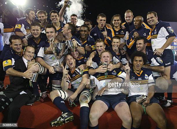 Brumbies celebrate winning the Super 12 Rugby Final between the ACT Brumbies and the Crusaders on May 22 2004 at Canberra Stadium in Canberra...