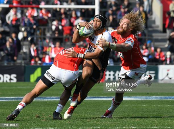 Brumbies' Christian Leali'ifano is tackled by Sunwolves' Timothy Lafaele and Willem Britz during their Super Rugby match between Japan's Sunwolves...
