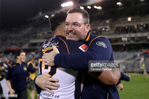 Brumbies coach Dan McKellar and Irae Simone of the Brumbies celebrate winning the Super Rugby AU Grand Final between the Brumbies and the Reds at GIO...
