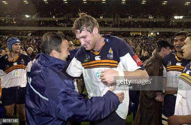 Brumbies coach Eddie Jones prepares to hug Justin Harrison after the Super12 rugby final won 366 by the Brumbies over the Sharks at Bruce Stadium...