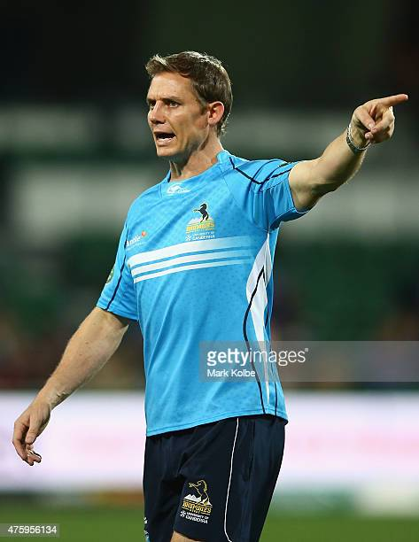 Brumbies coach Stephen Larkham gives instructions during the warm up ahead of the round 17 Super Rugby match between the Western Force and the...