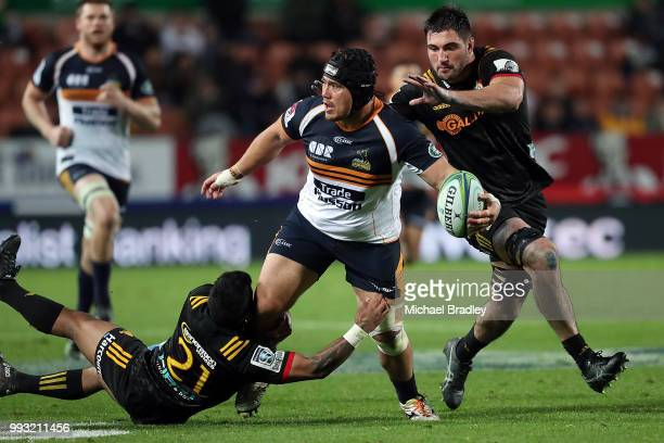 Brumbies Leslie Leuluaialii-Makin passes the ball in the tackle during the round 18 Super Rugby match between the Chiefs and the Brumbies at FMG...