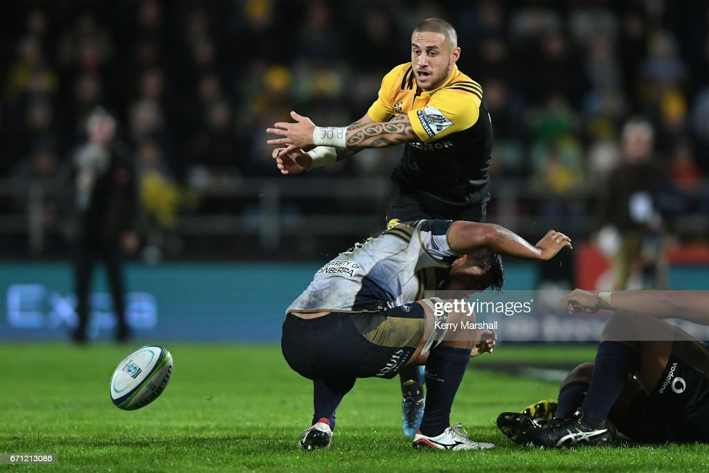 A Brumbies player gets in the way as TJ Perenara of the Hurricanes passes during the round nine Super Rugby match between the Hurricanes and the Brumbies at McLean Park on April 21, 2017 in Napier, New Zealand.