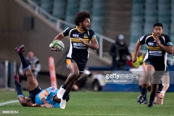Brumbies player Henry Speight breaks the tackle of Waratahs player Taqele Naiyaravoro at week 19 of the Super Rugby between The Waratahs and Brumbies...