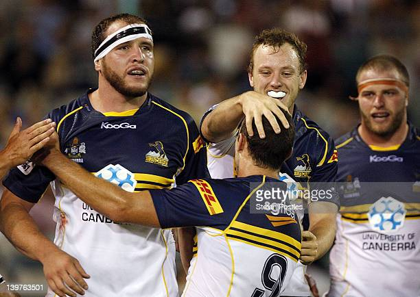 Brumbies players Ben Alexander Nic White and Jesse Mogg celebrate after a try is scored during the round one Super Rugby match between the Brumbies...