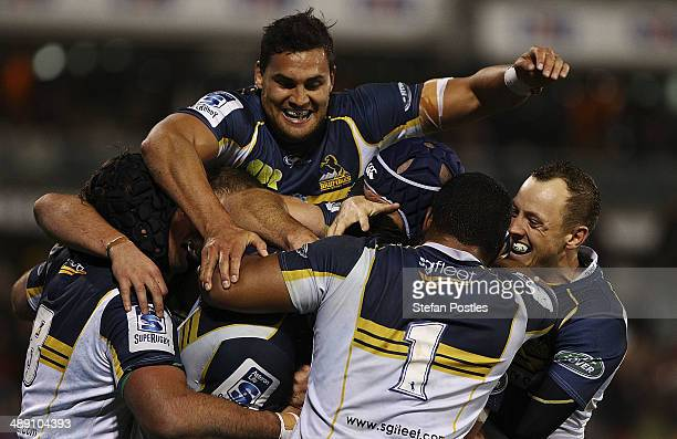 Brumbies players celebrate after a try by Sam Carter during the round 13 Super Rugby match between the Brumbies and the Sharks at Canberra Stadium on...
