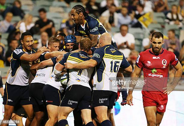 Brumbies players celebrate after James Dargaville scored a try during the round one Super Rugby match between the Brumbies and the Reds at GIO...