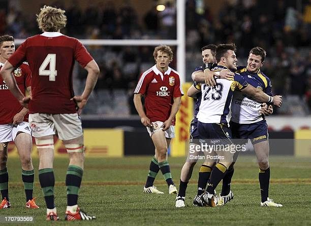 Brumbies players celebrate after winning the International tour match between the ACT Brumbies and the British & Irish Lions at Canberra Stadium on...