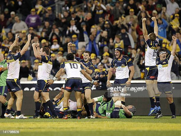Brumbies players celebrate after winning the round five Super Rugby match between the Brumbies and the Highlanders at Canberra Stadium on March 24...