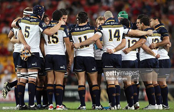 Brumbies players embrace in a team huddle before the round 12 Super 14 match between the Reds and the Brumbies at Suncorp Stadium on May 2 2009 in...