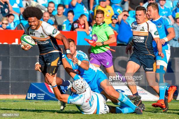 Brumbies's Fidji's winger Henry Speight is tackled by Bulls' South African scrum-half Handre Pollard during the SuperRugby rugby match between the...