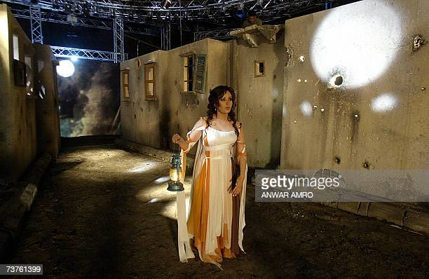 Tuisian singer Latifa performs at a set showing destroyed buildings during the shooting of a video clip for her song Amenli Beit in the village of...