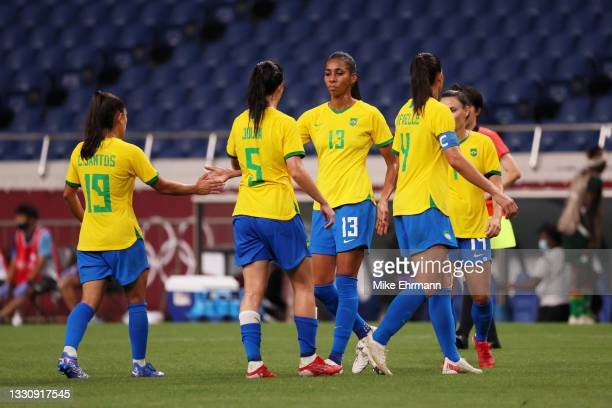 Bruna Benites of Team Brazil interacts with Leticia Santos and Julia after during the Women's Group F match between Brazil and Zambia on day four of...
