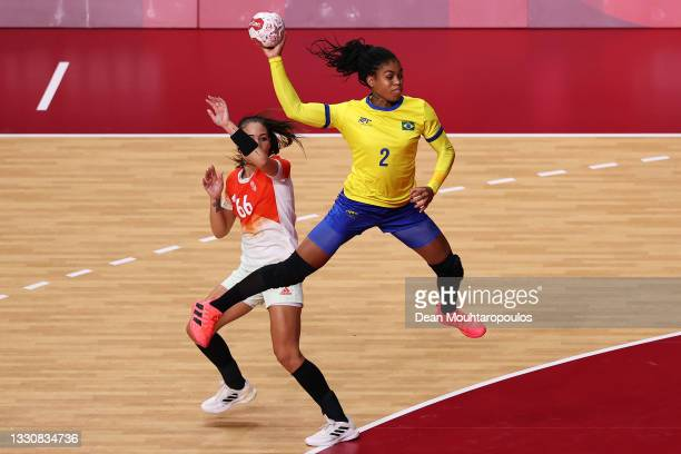 Bruna de Paula of Team Brazil shoots at goal as Viktoria Lukacs of Team Hungary looks on during the Woman's Preliminary Round Group B match between...