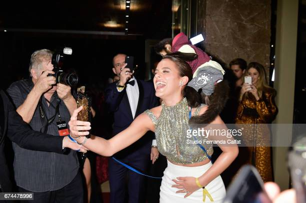 Bruna Marquezine plays and takes photos during the 7th Annual amfAR Inspiration Gala on April 27 2017 in Sao Paulo Brazil