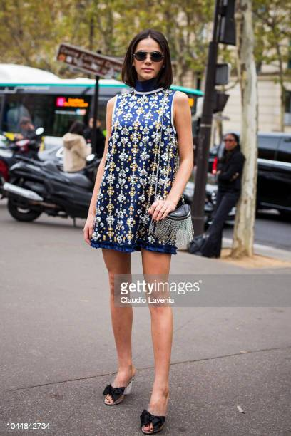 Bruna Marquezine wearing a decorated mini dress is seen before the Miu Miu show on October 2 2018 in Paris France