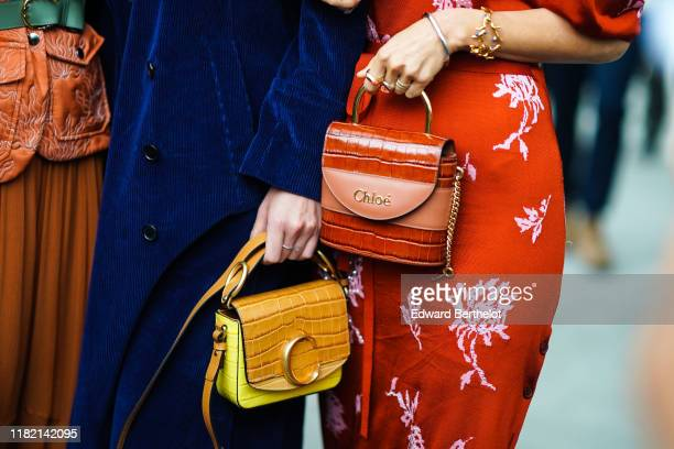Bruna Marquezine wears a navy blue corduroy long coat, a caramel-color and yellow crocodile pattern Chloe bag ; Aimee Song wears a red puff sleeves...