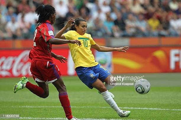 Bruna of Equatorial Guinea challenges Marta of Brazil during the FIFA Women's World Cup 2011 Group D match between Equatorial Guinea and Brazil at...