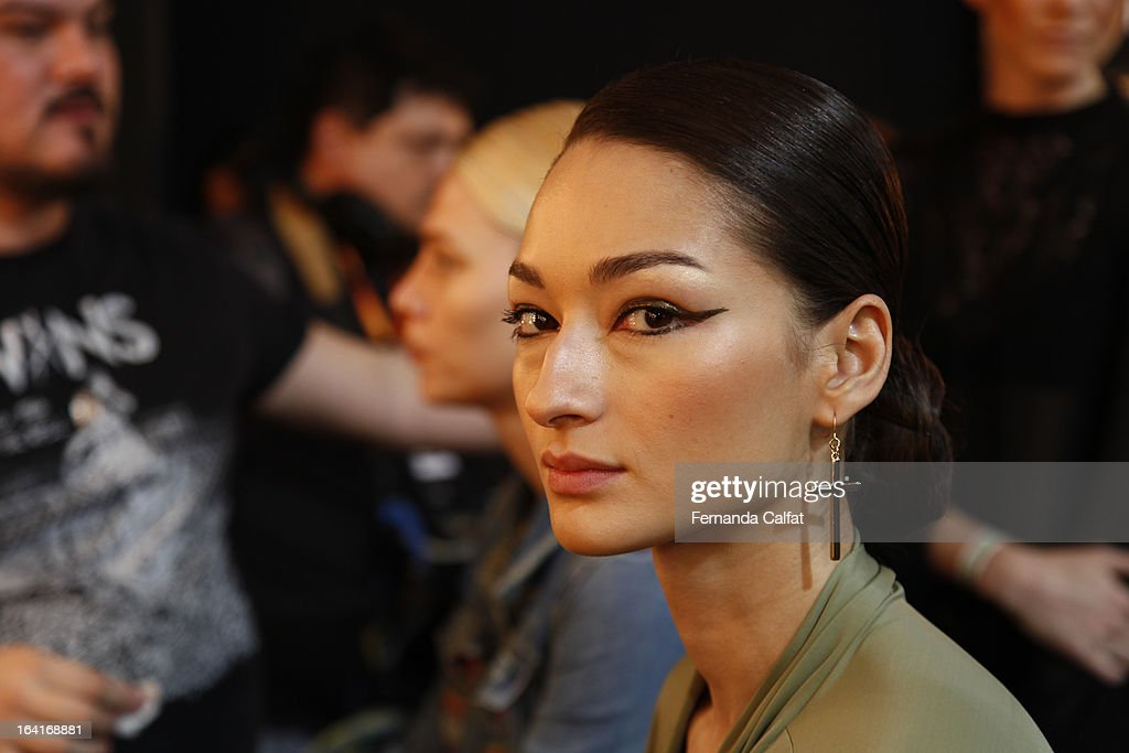 Bruna Tenorio prepares backstage at the Agua de Coco show during Sao Paulo Fashion Week Summer 2013/2014 on March 20, 2013 in Sao Paulo, Brazil.