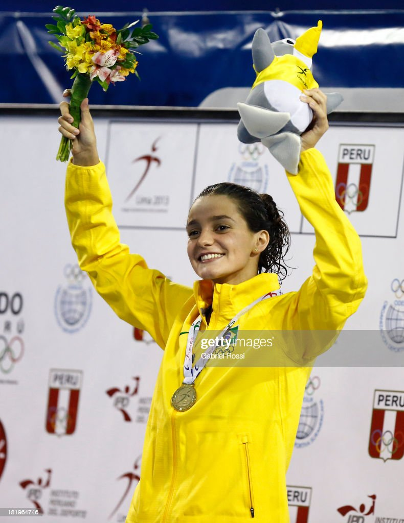 Bruna Veronez of Brazil poses with her gold medal after the 200 meters backstroke as part of the I ODESUR South American Youth Games at Piscina Ol'mpica Campo de Marte on September 26, 2013 in Lima, Peru.