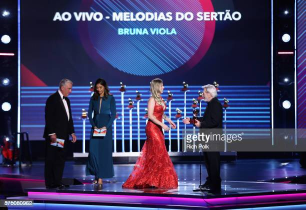 Bruna Viola accepts Best Brazilian Roots Music Album for 'Ao Vivo Melodias Do Sertao' from Cesar Camargo Mariano onstage at the Premiere Ceremony...