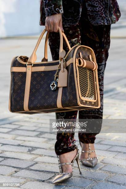 Brunay Cloe wears Valentino shoes, Versace dress, Louis Vuitton bag dog, Dior sunglasses and Lulu da Pomerania dog during Lisbon Fashion Week...