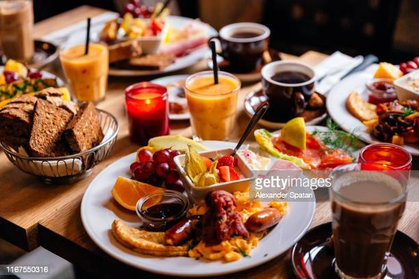 brunch at the cafe, side view - danish culture stock pictures, royalty-free photos & images