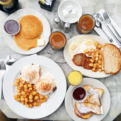 Brunch with eggs Benedict, pancakes, french toast, potato, coffee and juice - gettyimageskorea
