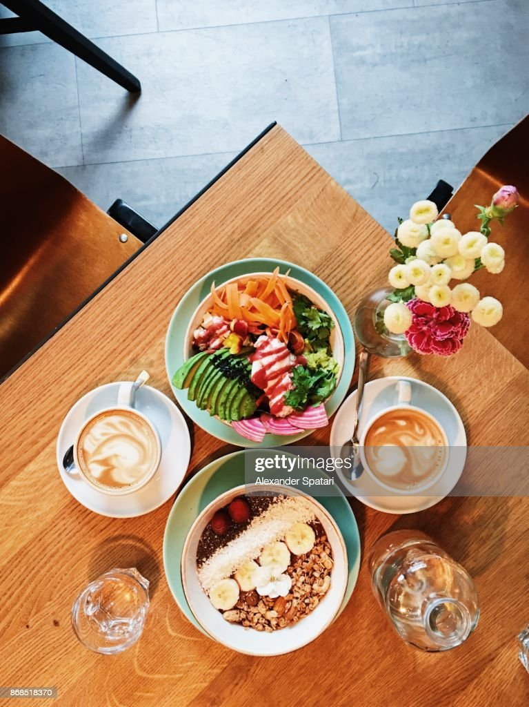Brunch with quinoa bowl, acai bowl and coffee, high angle view : Stock Photo