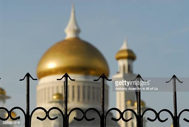 Brunei Darussalam Bandar Seri Begawan metal fence protecting Sultan Omar Ali Saifuddin Mosque in Bandar Seri Begawan with its golden dome