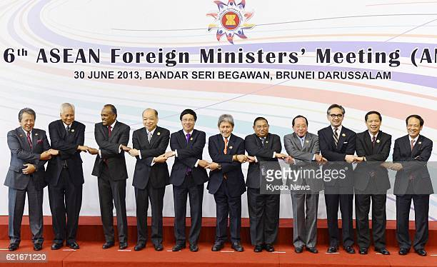 BEGAWAN Brunei Delegates from the Association of Southeast Asian Nations join hands during a photo session prior to talks at the 46th ASEAN Foreign...