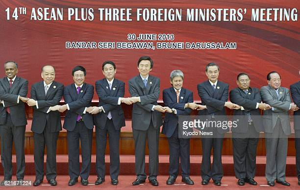 BEGAWAN Brunei Foreign ministers of the Association of Southeast Asian Nations and Japan China and South Korea join hands for photos prior to an...