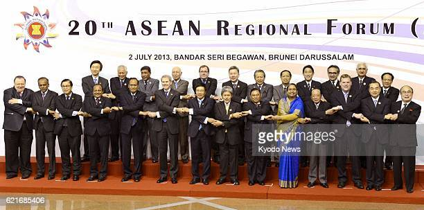 BEGAWAN Brunei Ministers pose during a photo session of an ASEAN Regional Forum ministerial meeting in Bandar Seri Begawan Brunei on July 2 2013 At R...