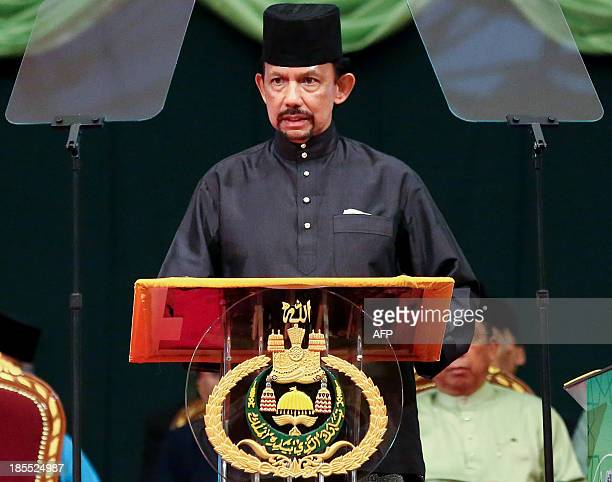 Brunei Sultan Hassanal Bolkiah delivers his speech during the official opening of the Majlis Ilmu 2013 in Bandar Seri Begawan on October 22 2013 The...