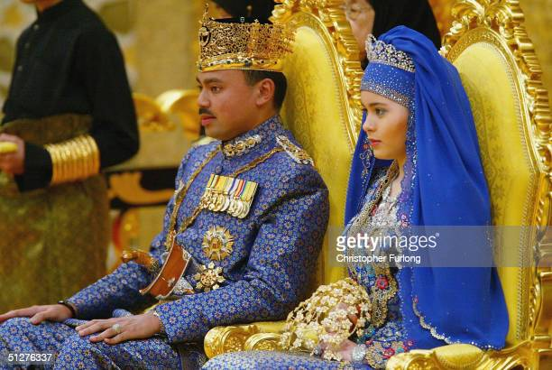 Bruneian Crown Prince AlMuhtadee Billah Bolkiah and his bride commoner Sarah Salleh sit in the throne chamber at the Balai Singgahsana Indera Buana...