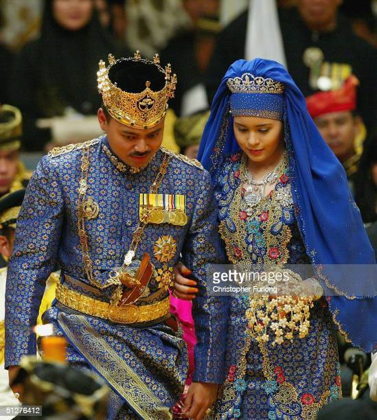 Bruneian Crown Prince AlMuhtadee Billah Bolkiah and his bride commoner Sarah Saleh sit in the throne chamber at the Balai Singgahsana Indera Buana on...