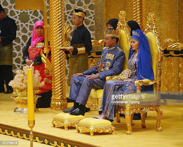 Bruneian Crown Prince AlMuhtadee Billah Bolkiah and his bride commoner Sarah Salleh sit in the throne chamber at the Balai Singgahsana Indera Buana...