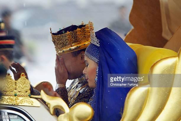 Bruneian Crown Prince AlMuhtadee Billah Bolkiah and his bride Princess Sarah brave a monsoon downpour during their wedding procession on September 9...