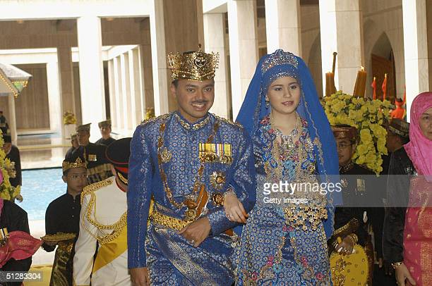 Bruneian Crown Prince AlMuhtadee Billah Bolkiah and his bride commoner Sarah Salleh are seen during their wedding in this official handout photo on...