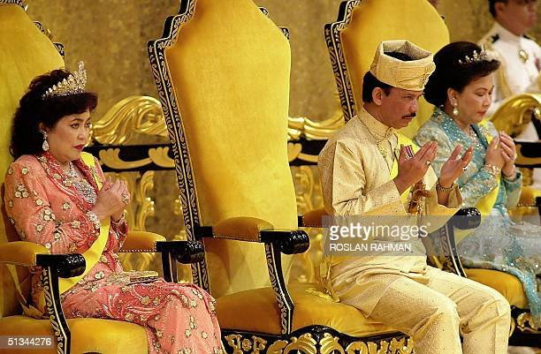 Bruneian Sultan Hassanal Bolkiah with his wives Queen Salleha AlMarhum and Queen Mariam Abdul Aziz in a prayer for blessing during the Sultan's 54th...